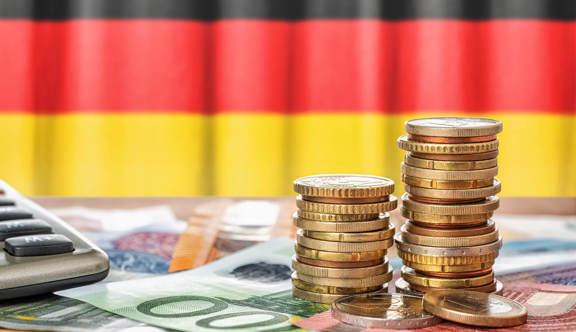 German flag and coins symbolize the limited-term reduction in German VAT rates.