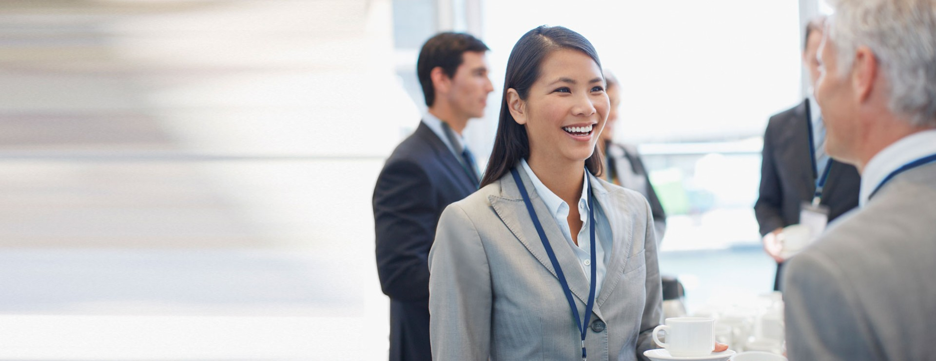 a young asian businesswoman talking to a senior businessman in a meeting