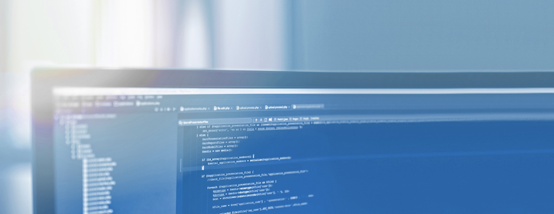 Close-up of the upper part of a blue desktop