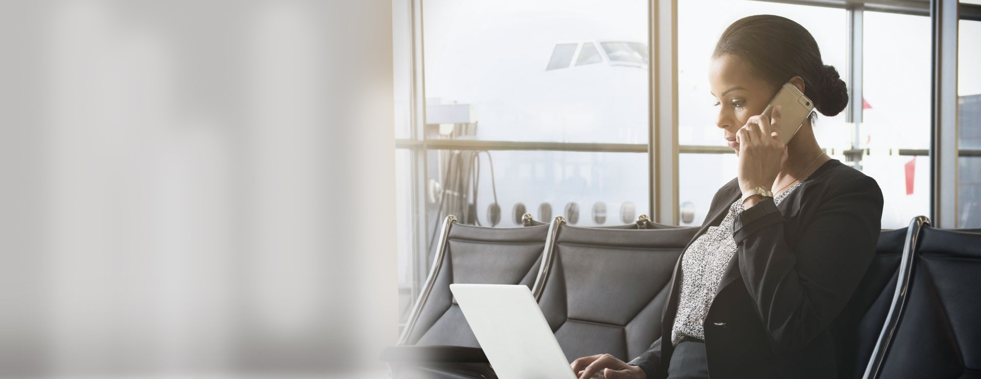 Businesswoman at airport mobile laptop