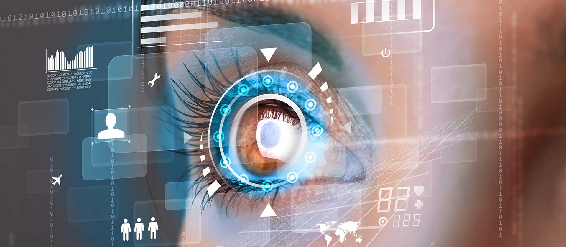 Occhio con proiezioni virtuali di numeri e grafici su uno screen digitale
