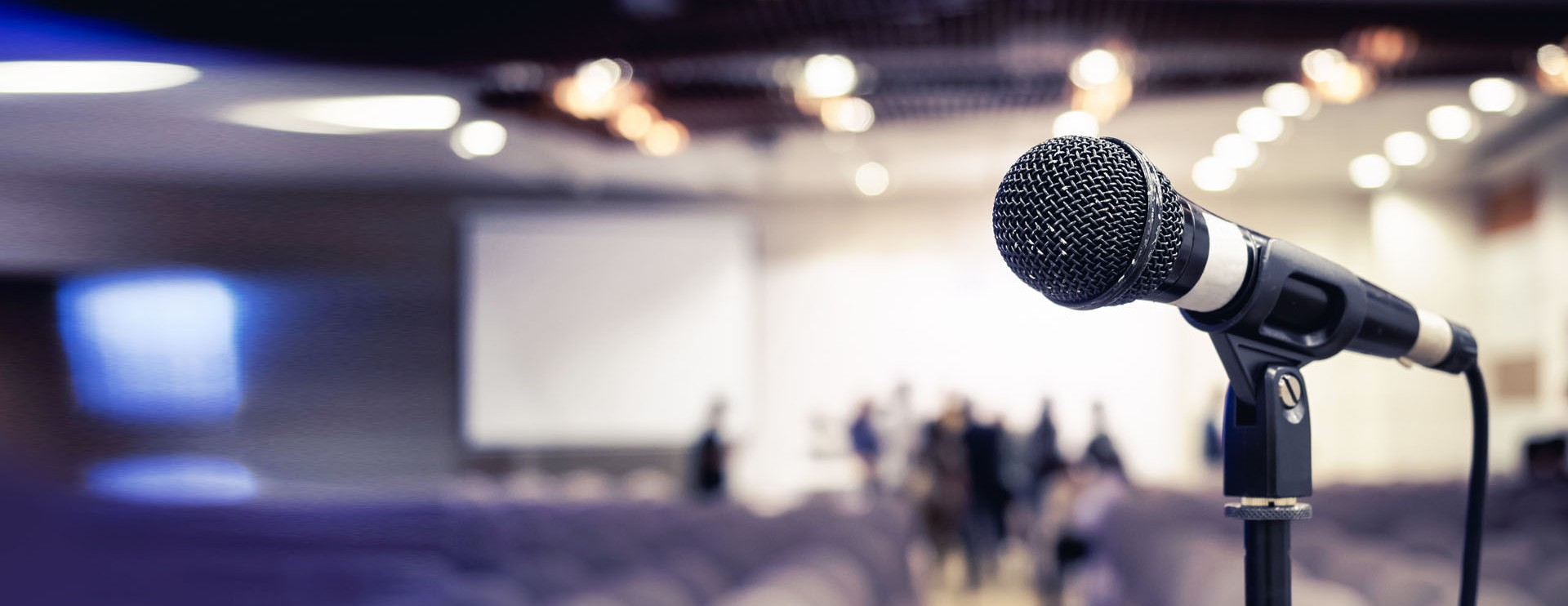 Close-up of a microphone in an auditorium