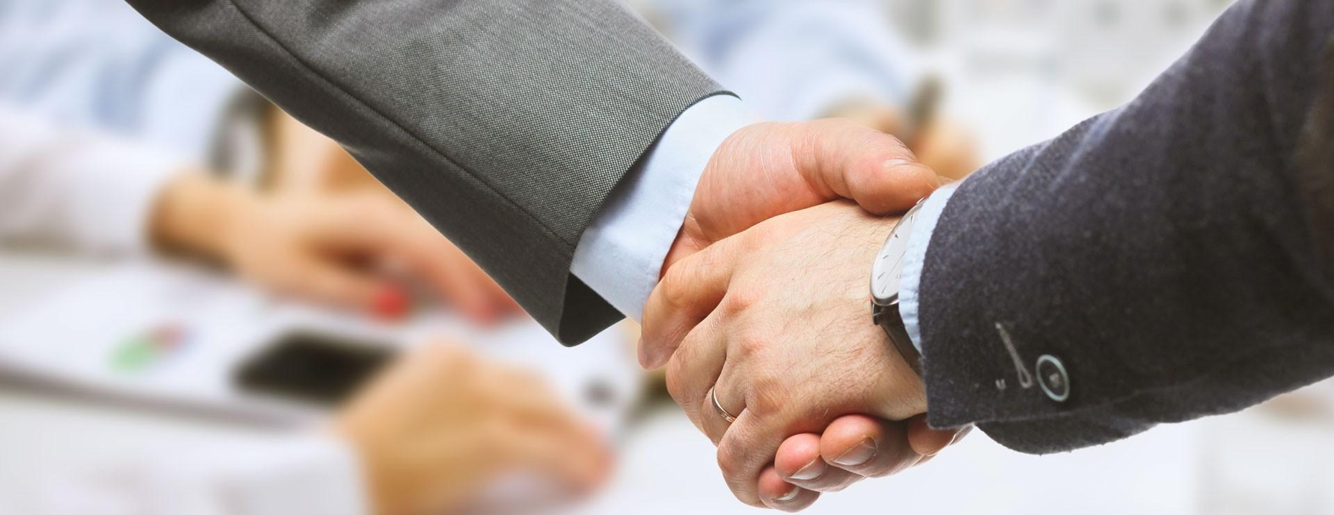 Handshake two businessmen