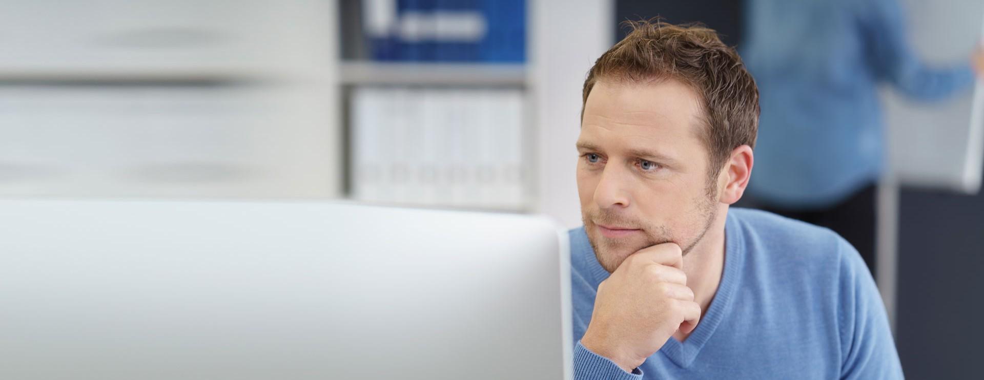 Man checking his laptop