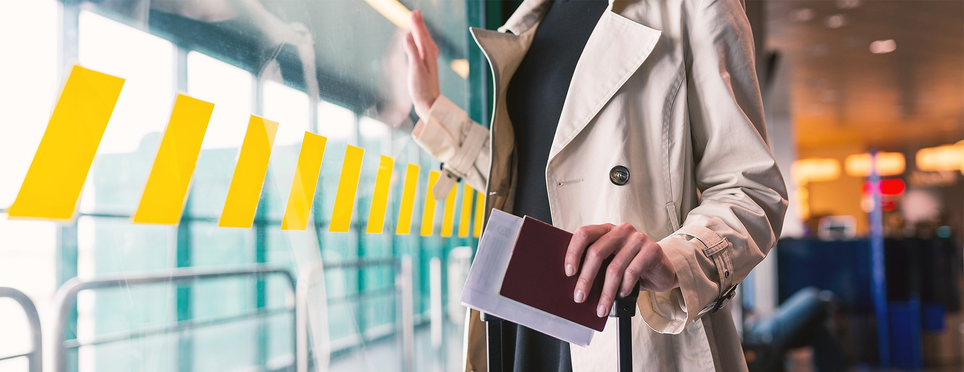 woman at airport with passport and further documents