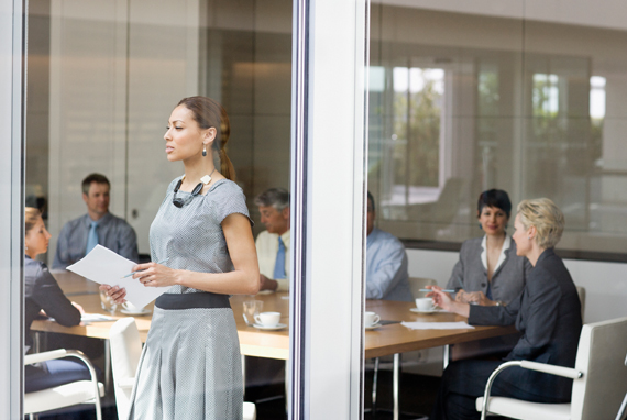 Business woman in front of a window in a meeting