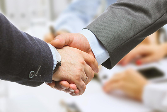 Handshake two businessmen
