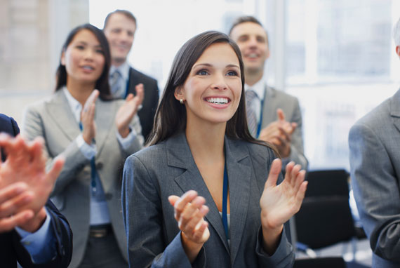 Event Management: Business people clapping